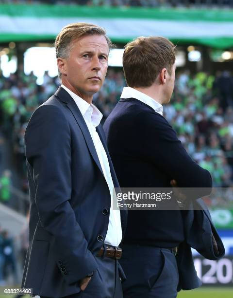 Head coach Andries Jonker of Wolfsburg stands next to sporting director Olaf Rebbe of Wolfsburg prior to the Bundesliga Playoff first leg match...