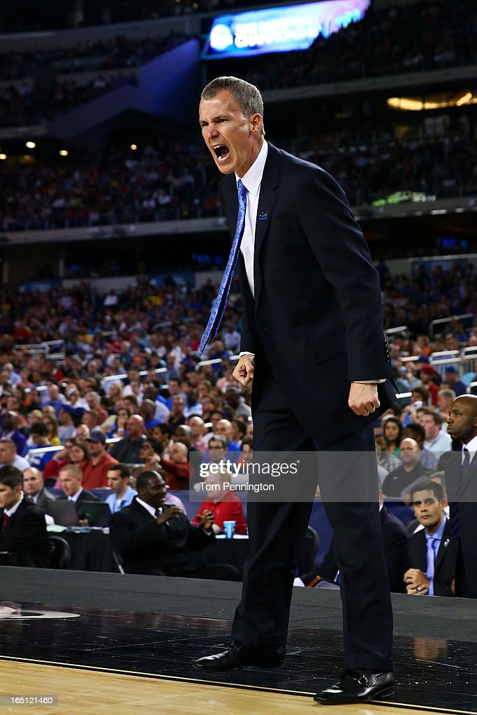 Head coach <a gi-track='captionPersonalityLinkClicked' href=/galleries/search?phrase=Andy+Enfield&family=editorial&specificpeople=5624033 ng-click='$event.stopPropagation()'>Andy Enfield</a> of the Florida Gulf Coast Eagles reacts against the Florida Gators during the South Regional Semifinal round of the 2013 NCAA Men's Basketball Tournament at Dallas Cowboys Stadium on March 29, 2013 in Arlington, Texas.