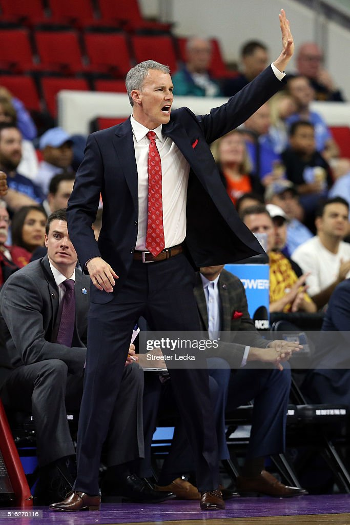 Head coach <a gi-track='captionPersonalityLinkClicked' href=/galleries/search?phrase=Andy+Enfield&family=editorial&specificpeople=5624033 ng-click='$event.stopPropagation()'>Andy Enfield</a> of the USC Trojans reacts in the first half against the Providence Friars during the first round of the 2016 NCAA Men's Basketball Tournament at PNC Arena on March 17, 2016 in Raleigh, North Carolina.
