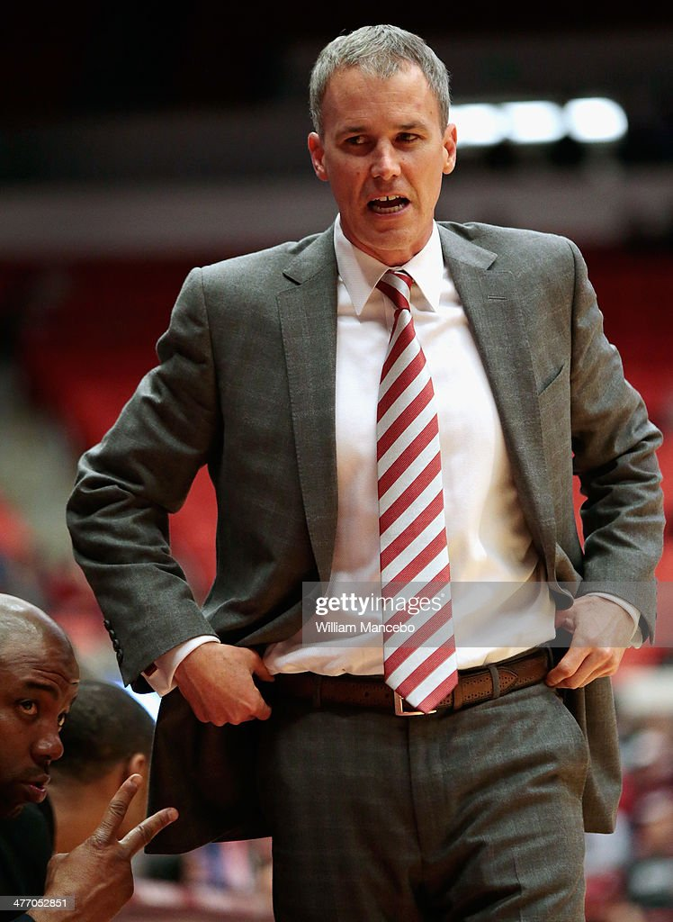 Head coach <a gi-track='captionPersonalityLinkClicked' href=/galleries/search?phrase=Andy+Enfield&family=editorial&specificpeople=5624033 ng-click='$event.stopPropagation()'>Andy Enfield</a> of the USC Trojans walks the sideline in front of his bench during the first half of the game against the Washington State Cougars at Beasley Coliseum on March 6, 2014 in Pullman, Washington.