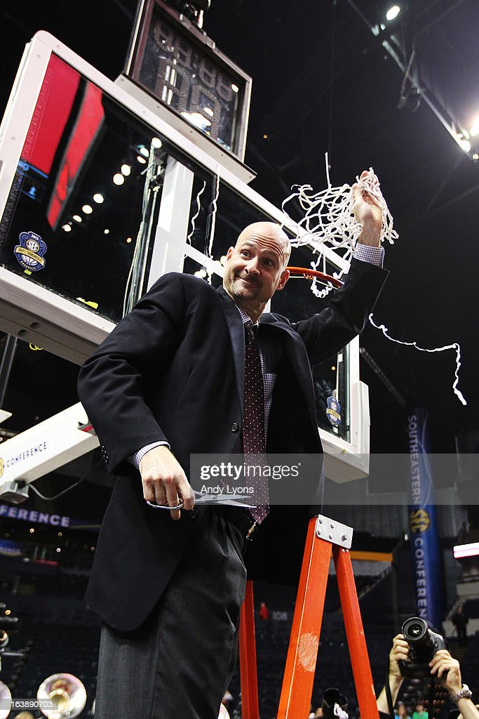 Head coach Andy Kennedy of the Ole Miss Rebels celebrates by cutting down a piece of the net after their 66 to 63 win over the Florida Gators in the SEC Basketball Tournament Championship game at Bridgestone Arena on March 17, 2013 in Nashville, Tennessee.