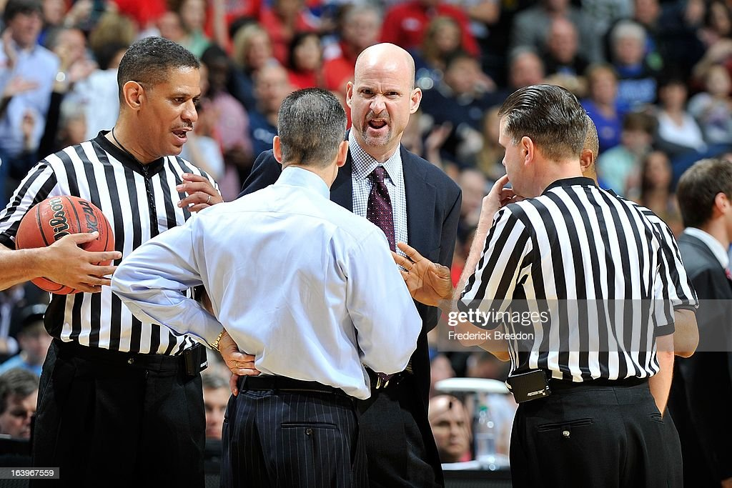 Head coach Andy Kennedy of the Ole Miss Rebels discusses a fould with officials and head coach Billy Donovan of the Florida Gators during the SEC Baskebtall Tournament Championship Game at Bridgestone Arena on March 17, 2013 in Nashville, Tennessee.