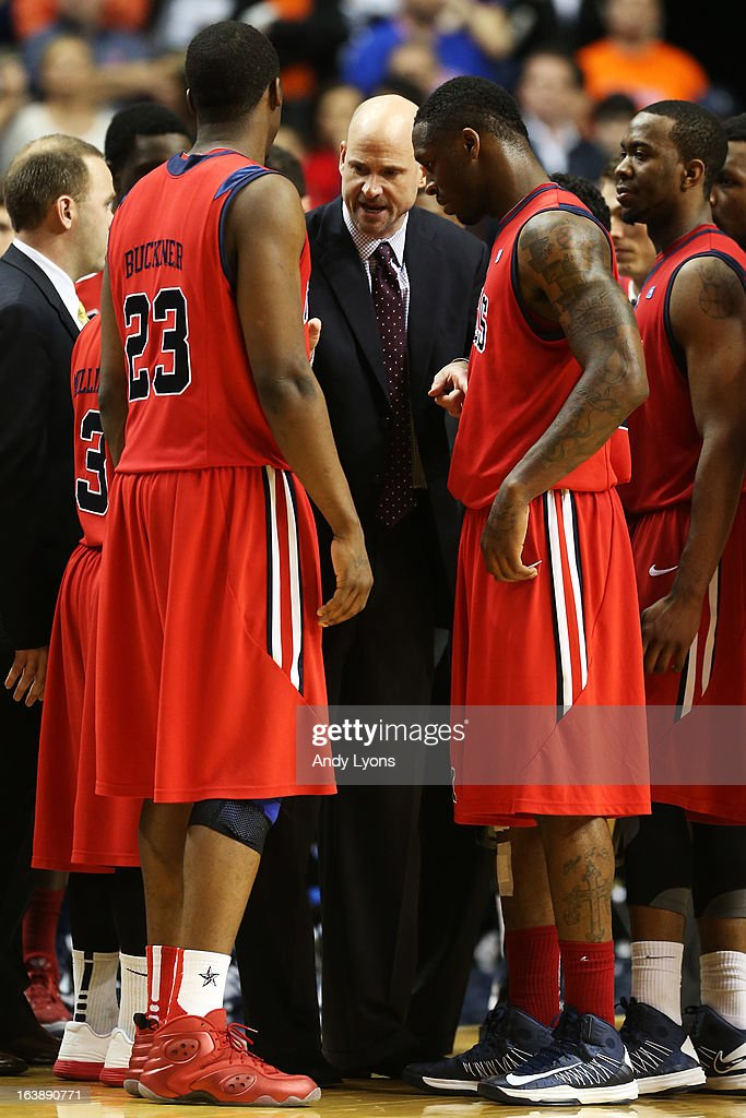 Head coach Andy Kennedy of the Ole Miss Rebels talks to his team in the second half against the Florida Gators during the SEC Basketball Tournament Championship game at Bridgestone Arena on March 17, 2013 in Nashville, Tennessee.