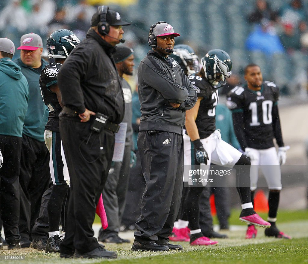 Head coach Andy Reid and defensive coordinator Todd Bowles of the Philadelphia Eagles look on during the final moments of a game against the Atlanta...