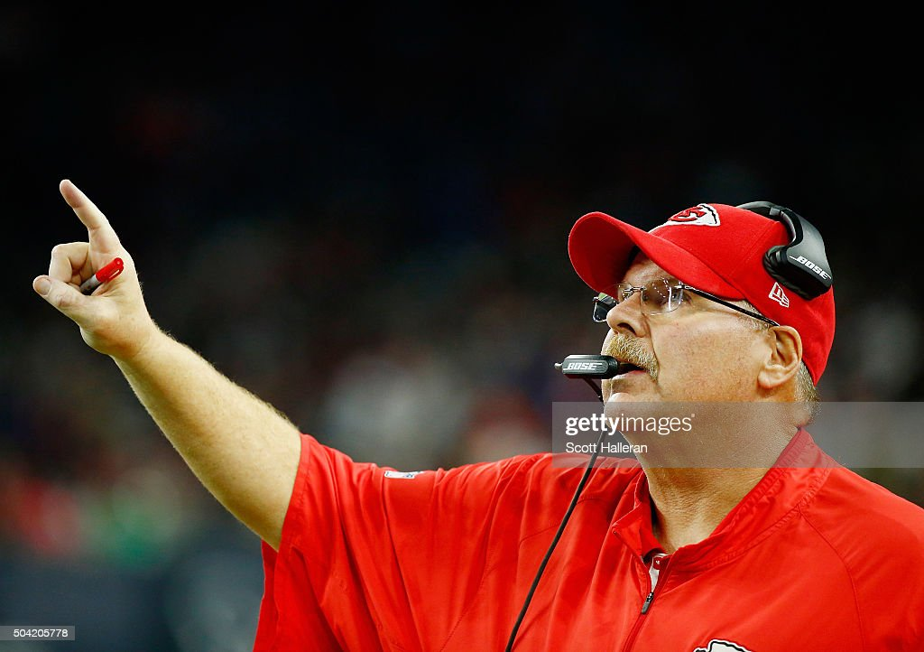 Head coach Andy Reid of the Kansas City Chiefs celebrates a fourth quarter touchdown against the Houston Texans during the AFC Wild Card Playoff game...