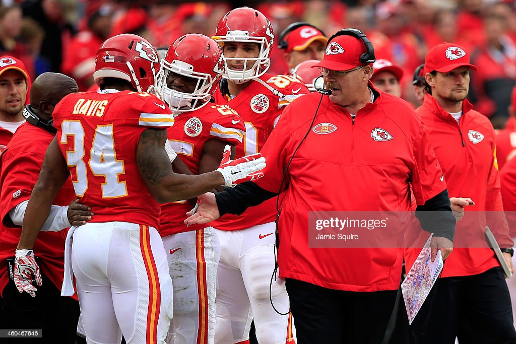 Head coach Andy Reid of the Kansas City Chiefs congratulates Knile Davis of the Kansas City Chiefs for a touchdown against the Oakland Raiders at...