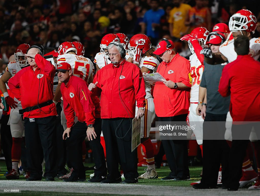 Head coach Andy Reid of the Kansas City Chiefs is seen among other players and coaches on the sidelines during the first half of the AFC Wild Card...