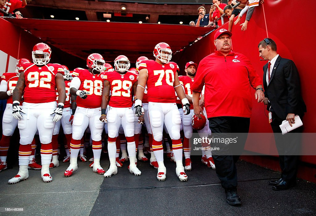 Head coach Andy Reid of the Kansas City Chiefs leads players onto the field during player introductions ahead of the game against the Houston Texans at Arrowhead Stadium on October 20, 2013 in Kansas City, Missouri.