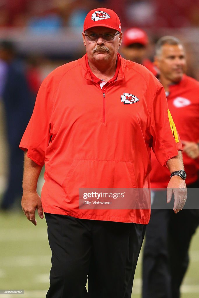 Head coach Andy Reid of the Kansas City Chiefs leaves there field after warmup prior to a preseason game against the St Louis Rams at the Edward...
