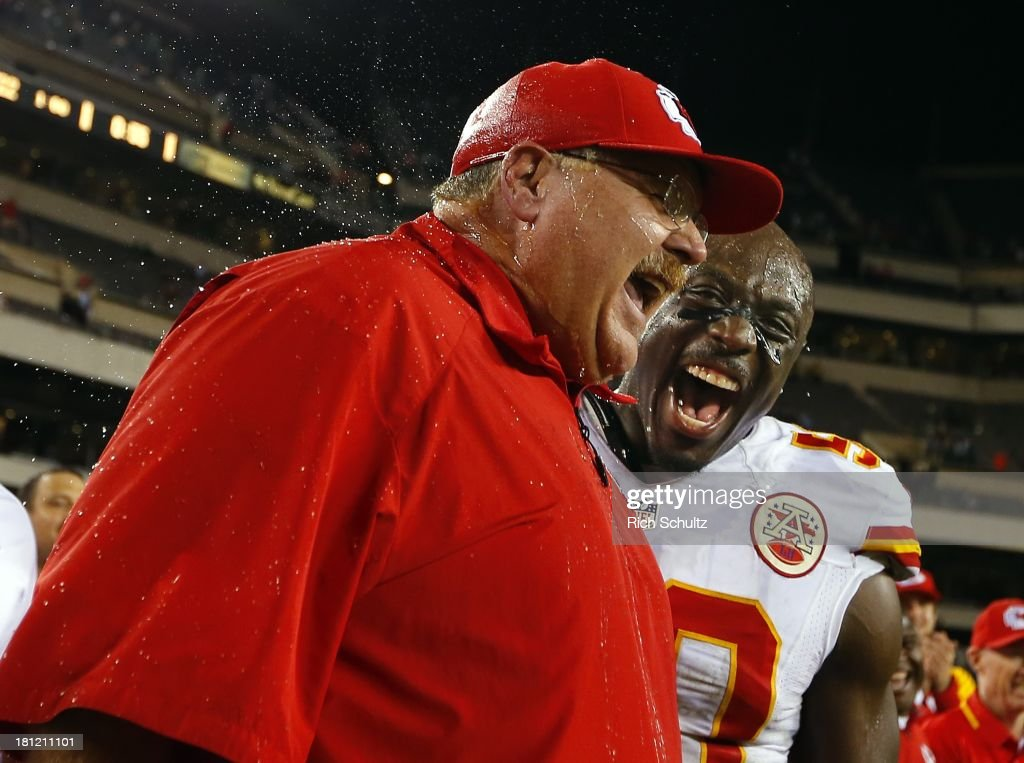 Head coach Andy Reid of the Kansas City Chiefs reacts to getting a Gatorade shower with linebacker Justin Houston #50 after defeating the Philadelphia Eagles 26-16 during a game at Lincoln Financial Field on September 19, 2013 in Philadelphia, Pennsylvania.