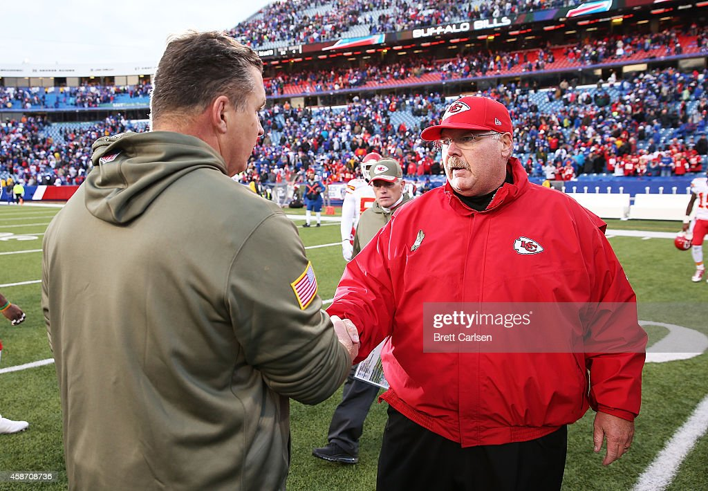 Head Coach Andy Reid of the Kansas City Chiefs shakes hands with Head Coach Doug Marrone of the Buffalo Bills after the football game at Ralph Wilson...