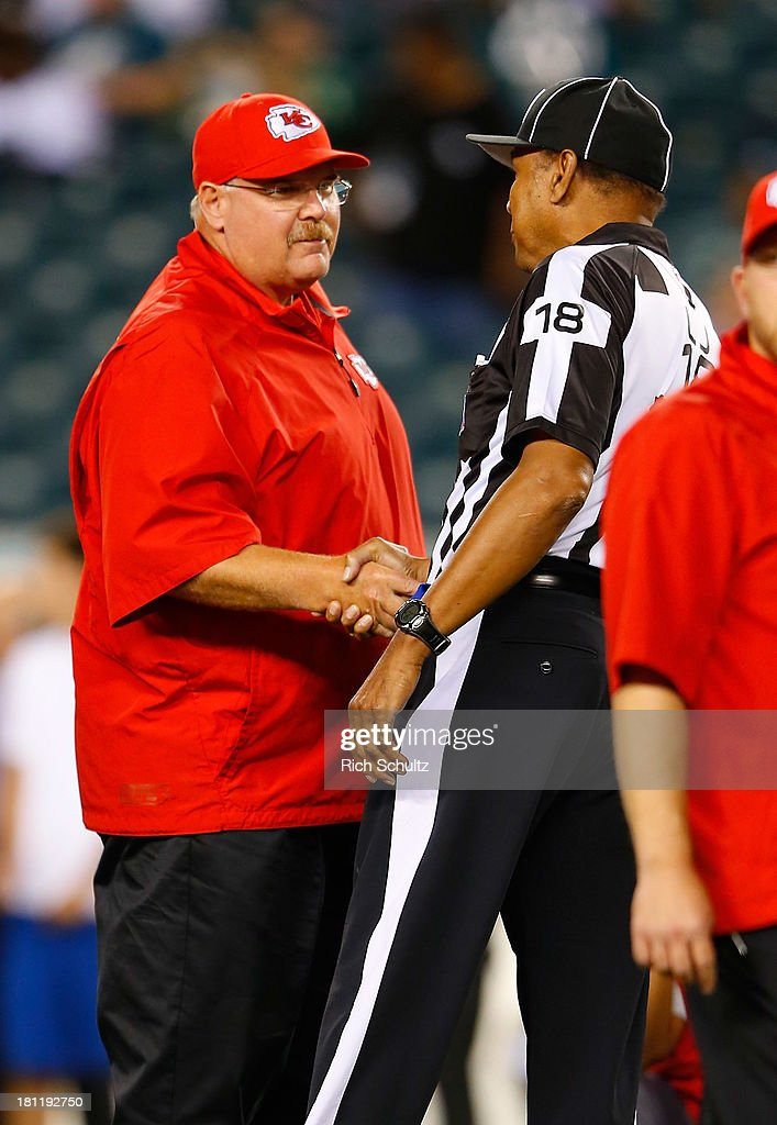 Head coach Andy Reid of the Kansas City Chiefs shakes hands with line judge Byron Boston #18 prior to the game against the Philadelphia Eagles at Lincoln Financial Field on September 19, 2013 in Philadelphia, Pennsylvania.