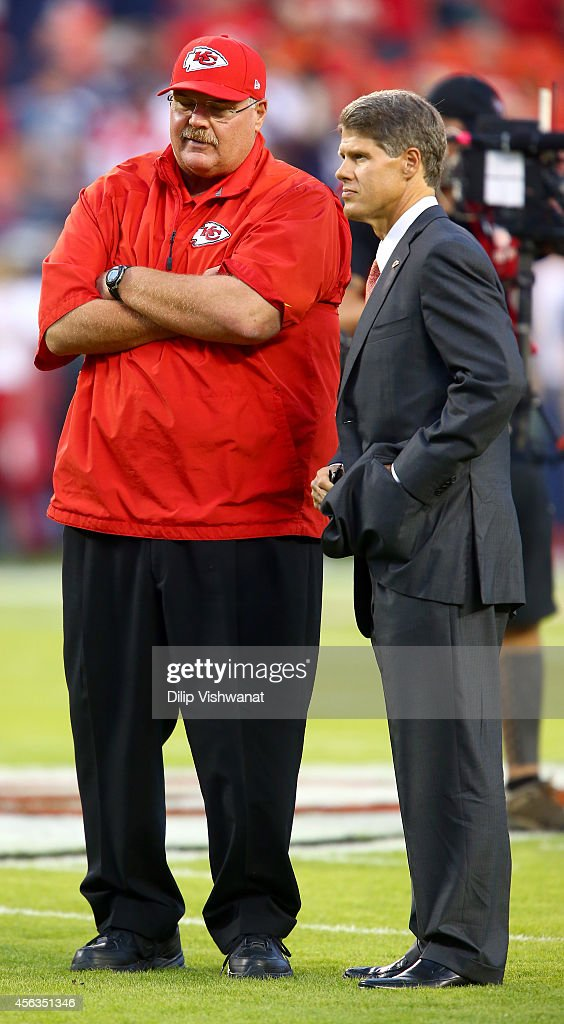 Head coach Andy Reid of the Kansas City Chiefs speaks with Kansas City Chiefs owner, <a gi-track='captionPersonalityLinkClicked' href=/galleries/search?phrase=Clark+Hunt&family=editorial&specificpeople=2138852 ng-click='$event.stopPropagation()'>Clark Hunt</a>, before the game against the New England Patriots at Arrowhead Stadium on September 29, 2014 in Kansas City, Missouri.
