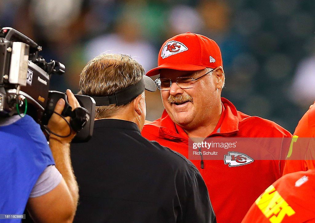 Head coach Andy Reid of the Kansas City Chiefs (R) talks to head coach Chip Kelly of the Philadelphia Eagles prior to the game at Lincoln Financial Field on September 19, 2013 in Philadelphia, Pennsylvania.