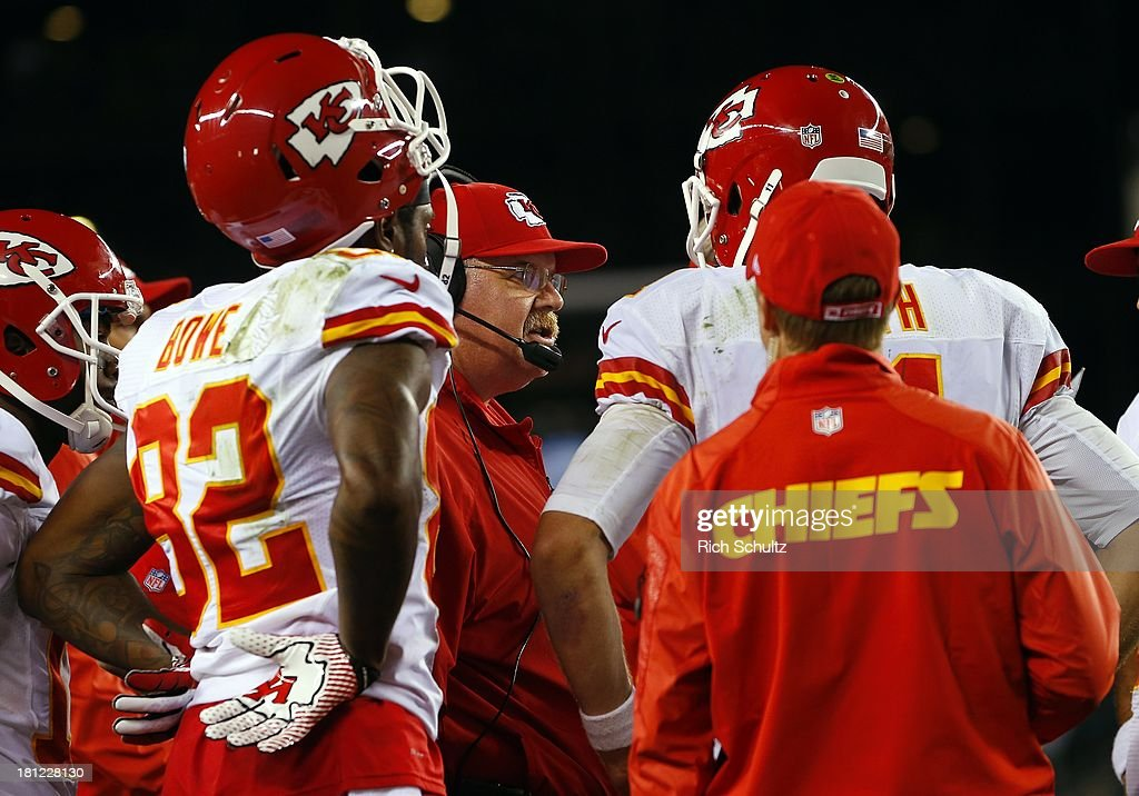 Head coach Andy Reid of the Kansas City Chiefs talks with players on the sidelines during the fourth quarter in a game against his former team, the Philadelphia Eagles at Lincoln Financial Field on September 19, 2013 in Philadelphia, Pennsylvania. The Chiefs defeated the Eagles 26-16.
