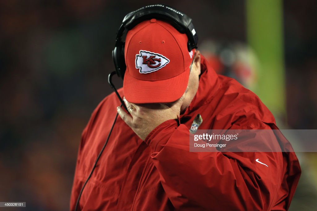 Head coach Andy Reid of the Kansas City Chiefs walks the sidelines as he faces the Denver Broncos at Sports Authority Field at Mile High on November 17, 2013 in Denver, Colorado. The Broncos defeated the Chiefs 27-17.