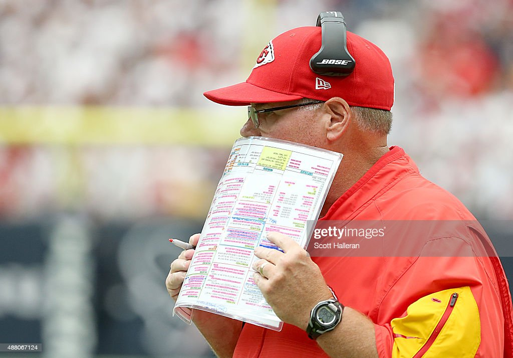 Head coach Andy Reid of the Kansas City Chiefs walks the sidelines while coaching against the Houston Texans in the second quarter in a NFL game on...