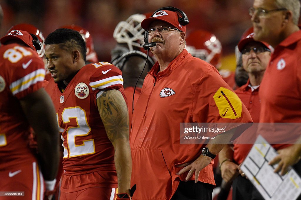 Head coach Andy Reid of the Kansas City Chiefs watches the action against the Denver Broncos during the first half of play at Arrowhead Stadium The...