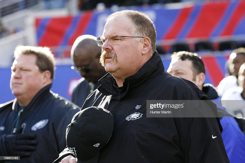 Head coach Andy Reid of the Philadelphia Eagles stands for the National Anthem before a game against the New York Giants on December 30, 2012 at MetLife Stadium in East Rutherford, New Jersey. The Giants won 42-7.