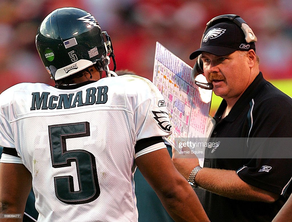 Head coach Andy Reid of the Philadelphia Eagles talks with quarterback Donovan McNabb during the second half of the game against the Kansas City...