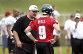 Head coach Andy Reid talks to quarterback Andy Hall of the Philadelphia Eagles during training camp on July 30 2004 at Lehigh University in Bethlehem...