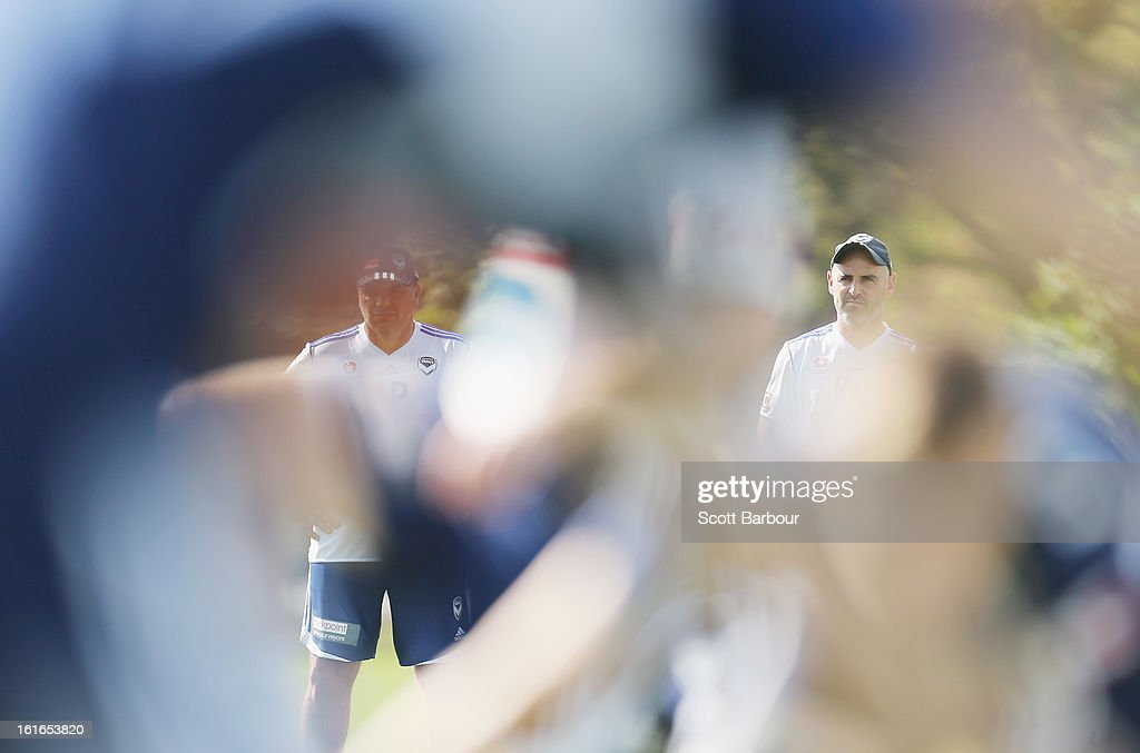 Head coach Ange Postecoglou (L) and assistant coach Kevin Muscat of the Victory look on during a Melbourne Victory A-League training session at Gosch's Paddock on February 14, 2013 in Melbourne, Australia.
