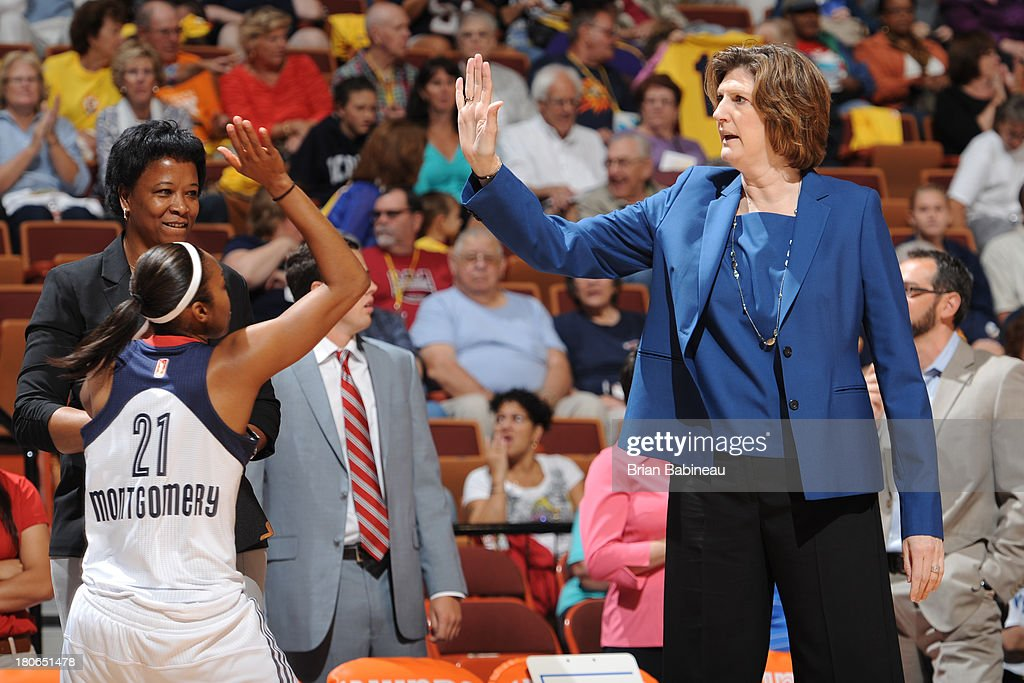 Head coach Anne Donovan high fives Renee Montgomery of the Connecticut Sun before the game against the Indiana Fever on September 15 2013 at the...