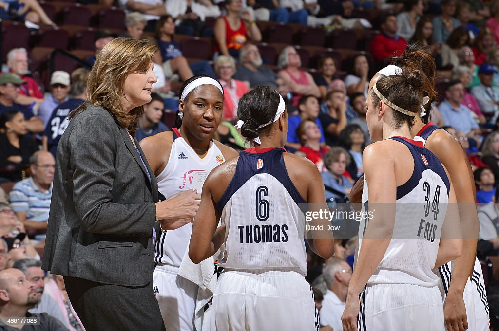 Head coach Anne Donovan of the Connecticut Sun talks to her players during a time out against the Phoenix Mercury on August 27 2015 at the Mohegan...