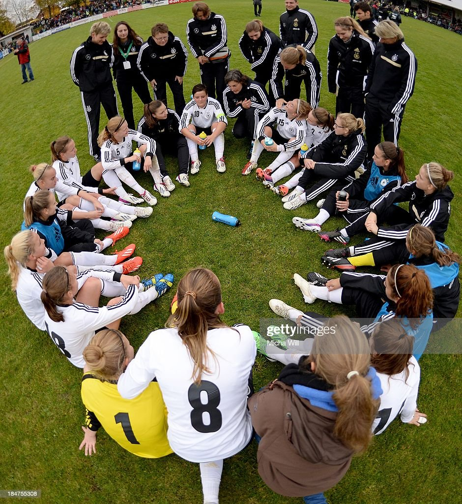 head coach Anouschka Bernhard (C) of Germany talks to her players after her team won the U17 Girls Euro Qualifier match between Germany and Belgium at Bioenergie-Arena on October 16, 2013 in Grossbardorf, Germany.