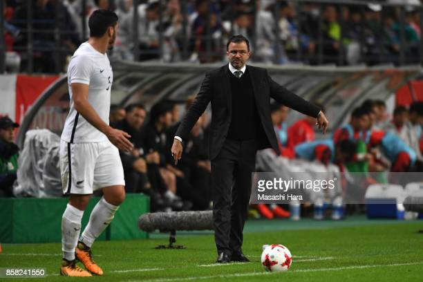 Head coach Anthony Hudson of New Zealand talks to Michael Boxall during the international friendly match between Japan and New Zealand at Toyota...