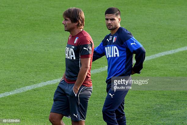 Head coach Antonio Conte and Lorenzo Insigne chat during an Italy training session at Coverciano on October 6 2015 in Florence Italy