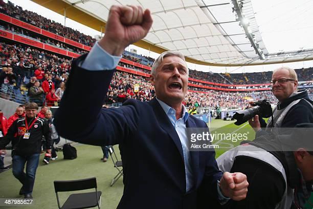 Head coach Armin Veh of Frankfurt celebrates with supporters after the Bundesliga match between Eintracht Frankfurt and Bayer Leverkusen at...