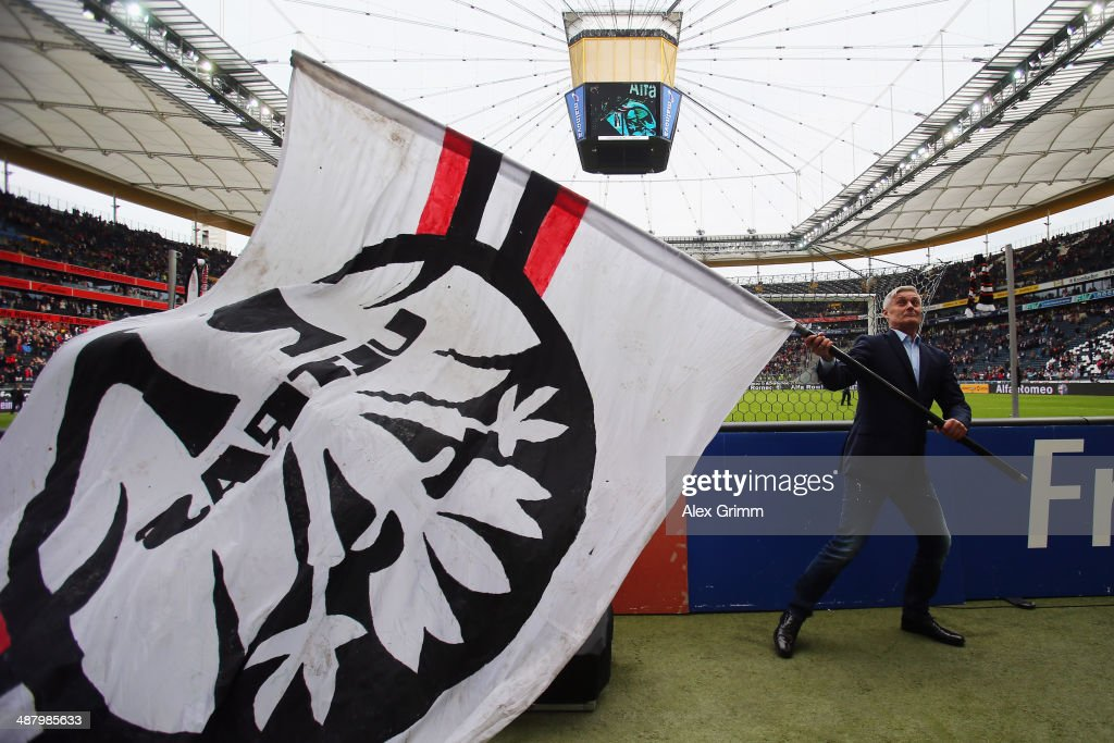 Head coach <a gi-track='captionPersonalityLinkClicked' href=/galleries/search?phrase=Armin+Veh&family=editorial&specificpeople=683317 ng-click='$event.stopPropagation()'>Armin Veh</a> of Frankfurt celebrates with supporters after the Bundesliga match between Eintracht Frankfurt and Bayer Leverkusen at Commerzbank Arena on May 3, 2014 in Frankfurt am Main, Germany.