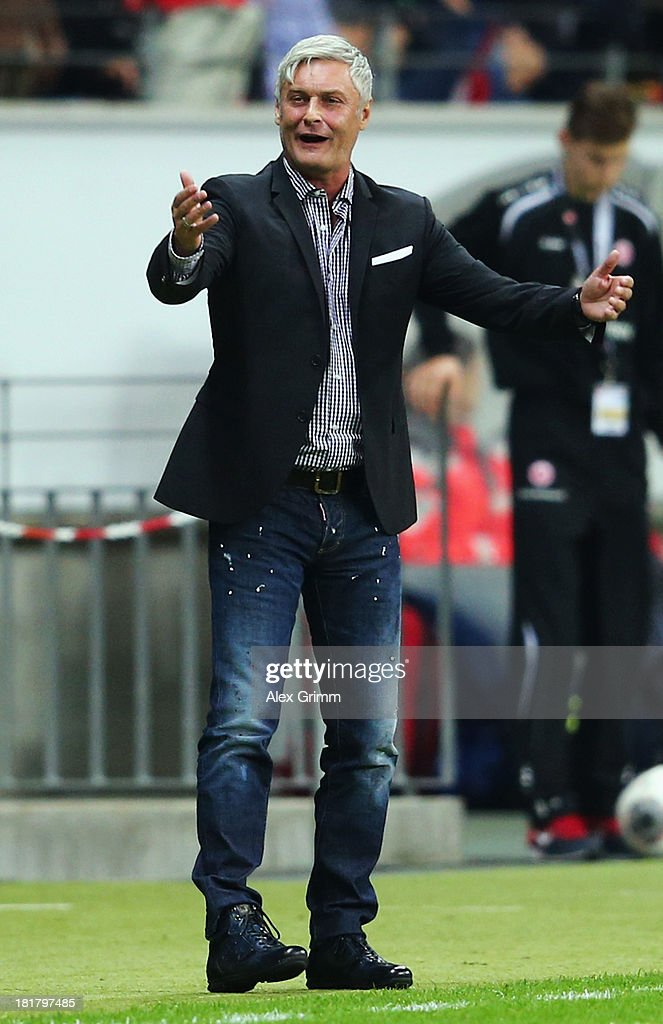 Head coach Armin Veh of Frankfurt reacts during the DFB Cup second round match between Eintracht Frankfurt and VfL Bochum at Commerzbank-Arena on September 25, 2013 in Frankfurt am Main, Germany.