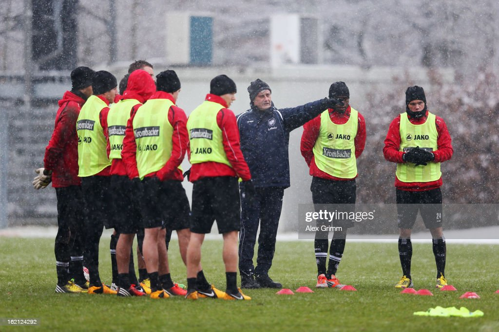 Head coach Armin Veh of Frankfurt talks to the players during a Eintracht Frankfurt training session at Commerzbank-Arena on February 19, 2013 in Frankfurt am Main, Germany.