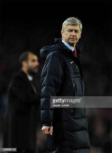 Head coach Arsene Wenger of Arsenal reacts backdropped by head coach Josep Guardiola of Barcelona during the UEFA Champions League round of 16 second...