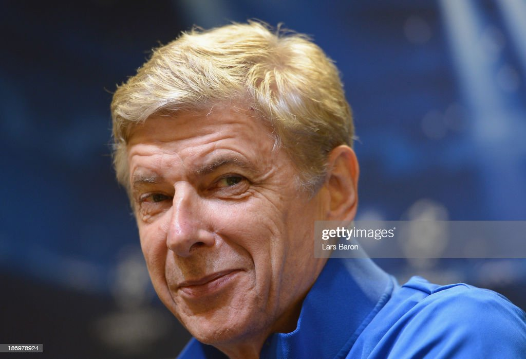 Head coach Arsene Wenger smiles during a Arsenal press conference ahead of the UEFA Champions League Group F match against Borussia Dortmund at Signal Iduna Park on November 5, 2013 in Dortmund, Germany.