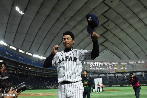 Head coach Atsunori Inaba of Japan applauds fans after his team's 87 victory in the Eneos Asia Professional Baseball Championship 2017 game between...