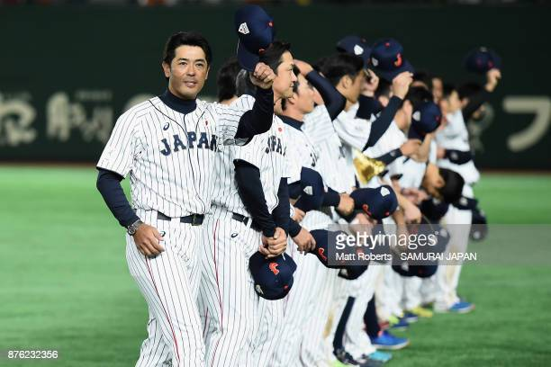 Head coach Atsunori Inaba of Japan applauds fans after the Eneos Asia Professional Baseball Championship 2017 final game between Japan and South...