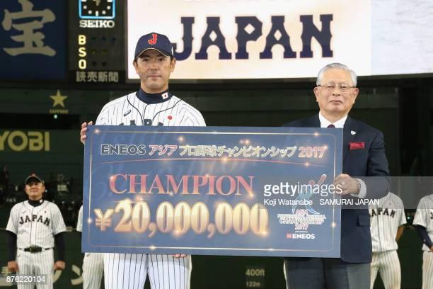 Head coach Atsunori Inaba of Japan poses for photographs with the Nippon Professional Baseball Commissioner Katsuhiko Kumazaki at the award ceremony...