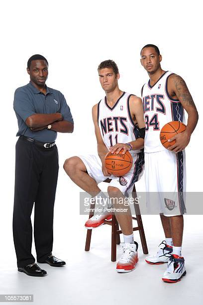 Head Coach Avery Johnson Brook Lopez and Devin Harris of the New Jersey Nets poses for a photo during Media Day on September 24 2010 at the PNY...