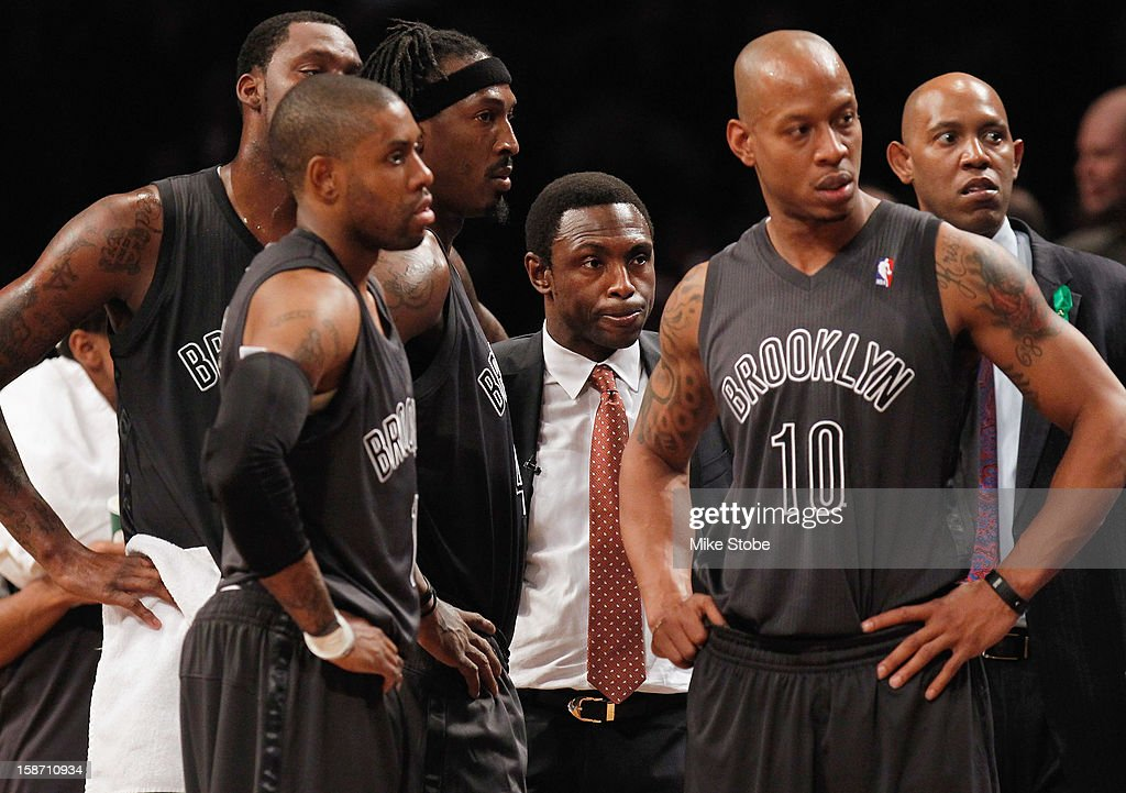 Head Coach Avery Johnson, Keith Bogans #10, Gerald Wallace #45 of the Brooklyn Nets look on from the bench against the Boston Celtics at the Barclays Center on December 25, 2012 in the Brooklyn borough of New York City.