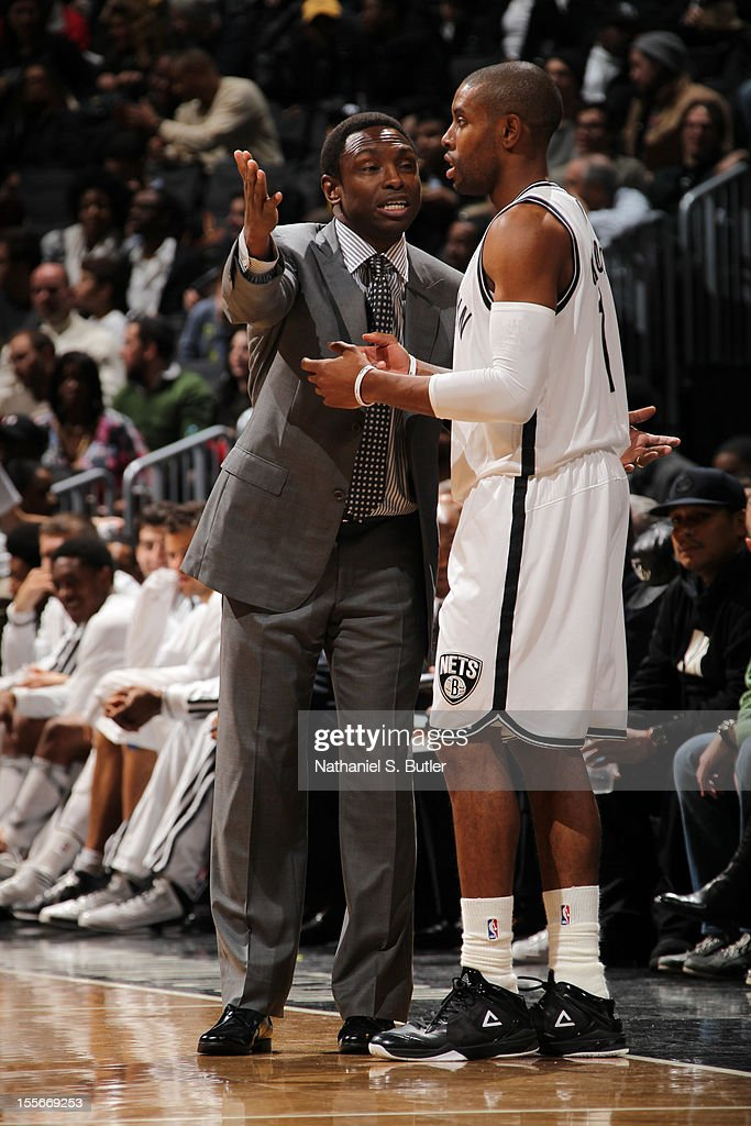 Head Coach Avery Johnson speaks to C.J. Watson #1 of the Brooklyn Nets against the Minnesota Timberwolves on November 5, 2012 at the Barclays Center in Brooklyn, New York.