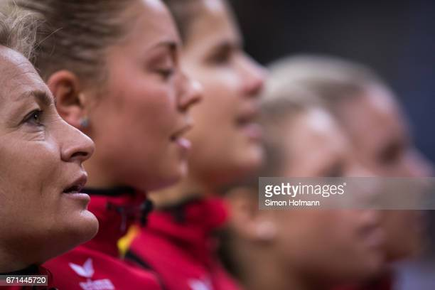 Head coach Barbara Rittner looks on during the national anthem ahead of the FedCup World Group PlayOff Match between Germany and Ukraine at Porsche...