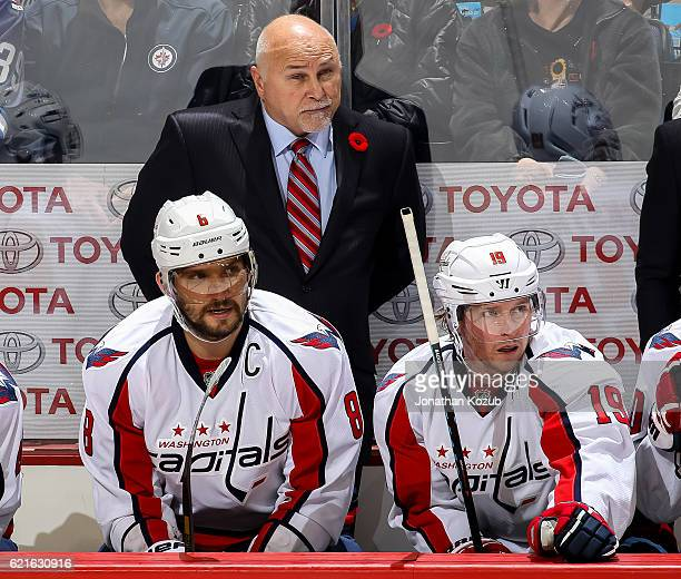 Head Coach Barry Trotz Alex Ovechkin and Nicklas Backstrom of the Washington Capitals look on from the bench during third period action against the...