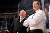 Head coach Barry Trotz and assistant coach Phil Housley of the Nashville Predators watch their team warmup prior to a game against the Tampa Bay...