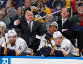 Head coach Barry Trotz and assistant coach Phil Housley of the Nashville Predators watch the action against the Buffalo Sabres on March 11 2014 at...