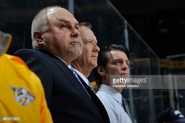 Head coach Barry Trotz and assistant head coaches Phil Housley and Lane Lambert of the Nashville Predators watch from the bench during a game against...