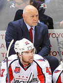 Head Coach Barry Trotz and Tom Wilson of the Washington Capitals look on from the bench during third period action against the Winnipeg Jets on March...
