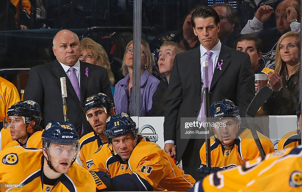 Head coach <a gi-track='captionPersonalityLinkClicked' href=/galleries/search?phrase=Barry+Trotz&family=editorial&specificpeople=212800 ng-click='$event.stopPropagation()'>Barry Trotz</a>, left, and assistant coach Lane Lambert of the Nashville Predators wear lavender ties and ribbons during the Hockey Fights Cancer night against the St. Louis Blues at Bridgestone Arena on October 26, 2013 in Nashville, Tennessee.